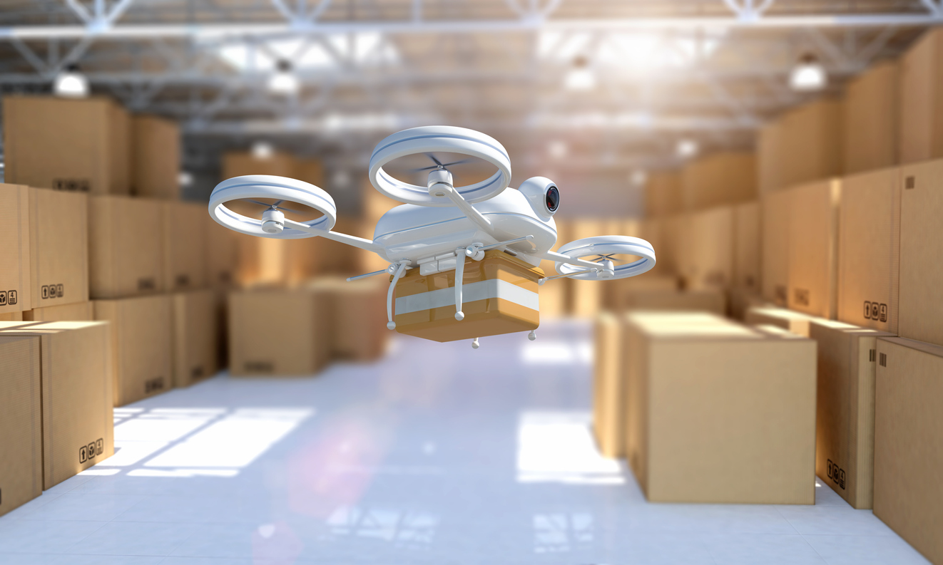 Remote controlled drone taking off from warehouse to deliver package